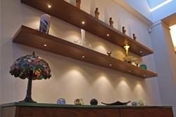 Uses Strategic Lighting with Shelves